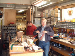 Bob Grunow (left) and Art Reblitz packing small parts for the move back to Montana.